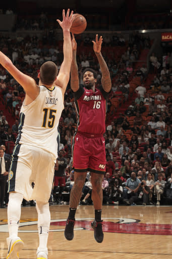 MIAMI, FL - MARCH 19: James Johnson #16 of the Miami Heat shoots the ball against the Denver Nuggets on March 19, 2018 at American Airlines Arena in Miami, Florida. (Photo by Oscar Baldizon/NBAE via Getty Images)