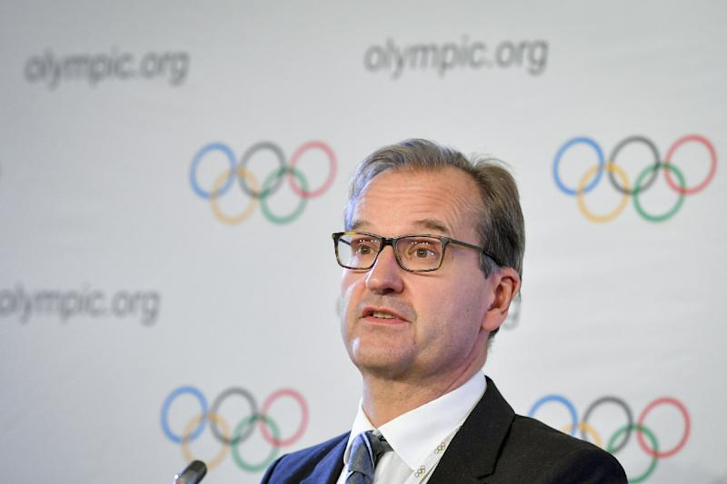International Olympic Committee spokesman Mark Adams attends a press conference during an IOC executive meeting