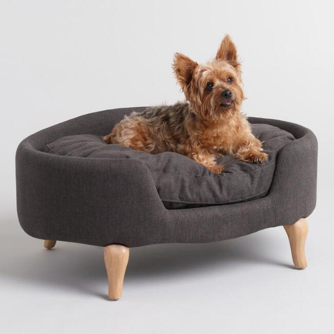 Charcoal Gray Upholstered Lola Pet Bed With Wood Legs (Photo: Wayfair)