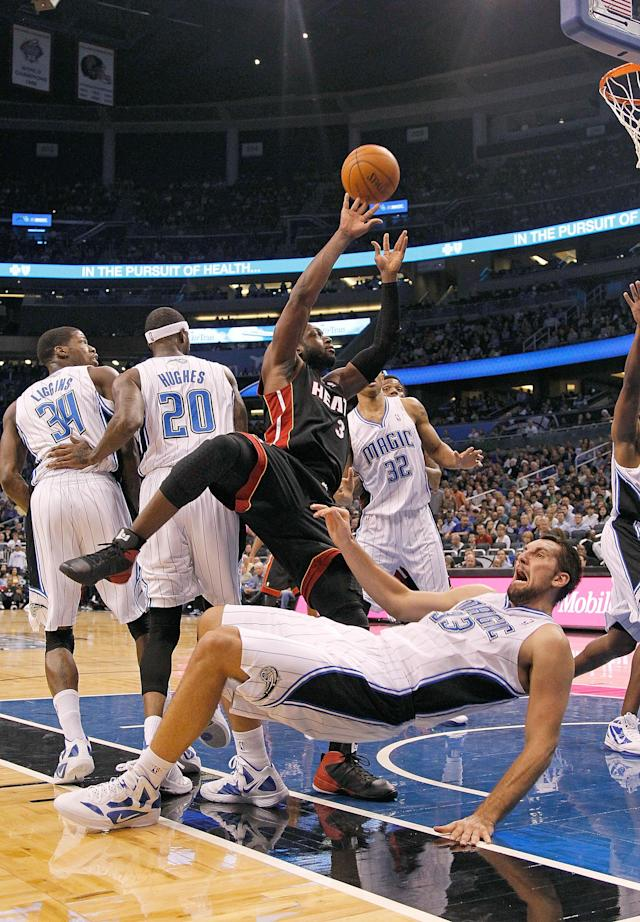 ORLANDO, FL - DECEMBER 21: Dwyane Wade #3 of the Miami Heat shoots over Ryan Anderson #33 of the Orlando Magic during a preseason game at Amway Center on December 21, 2011 in Orlando, Florida. NOTE TO USER: User expressly acknowledges and agrees that, by downloading and/or using this Photograph, User is consenting to the terms and conditions of the Getty Images License Agreement. (Photo by Mike Ehrmann/Getty Images)