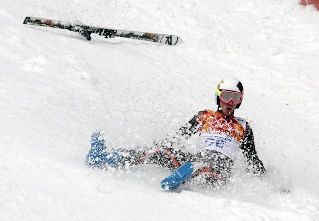 Spain's Alex Puente Tasias slides down the course after crashing during the first run of the men's giant slalom the Sochi 2014 Winter Olympics, Wednesday, Feb. 19, 2014, in Krasnaya Polyana, Russia. (AP Photo/Charles Krupa)