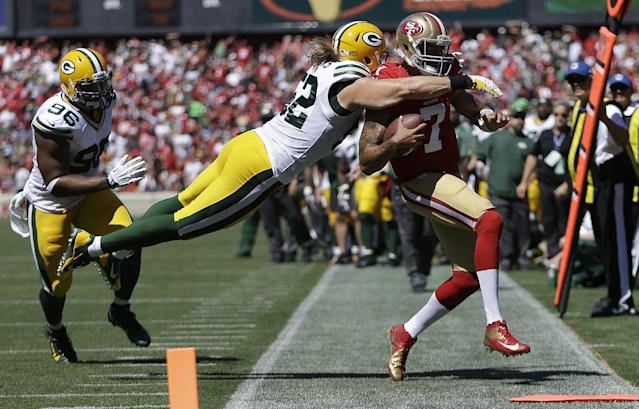 San Francisco 49ers quarterback Colin Kaepernick (7) runs out of bounds as Green Bay Packers outside linebacker Clay Matthews dives for him during the second quarter of an NFL football game in San Francisco, Sunday, Sept. 8, 2013. (AP Photo/Ben Margot)