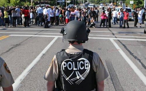 Police and protesters in Ferguson