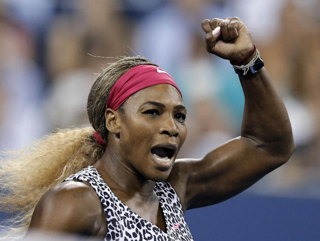 Serena Williams, of the United States, gestures after defeating Flavia Pennetta, of Italy, 6-3, 6-2 in the quarterfinals of the U.S. Open tennis tournament Wednesday, Sept. 3, 2014, in New York. (AP Photo/Darron Cummings)