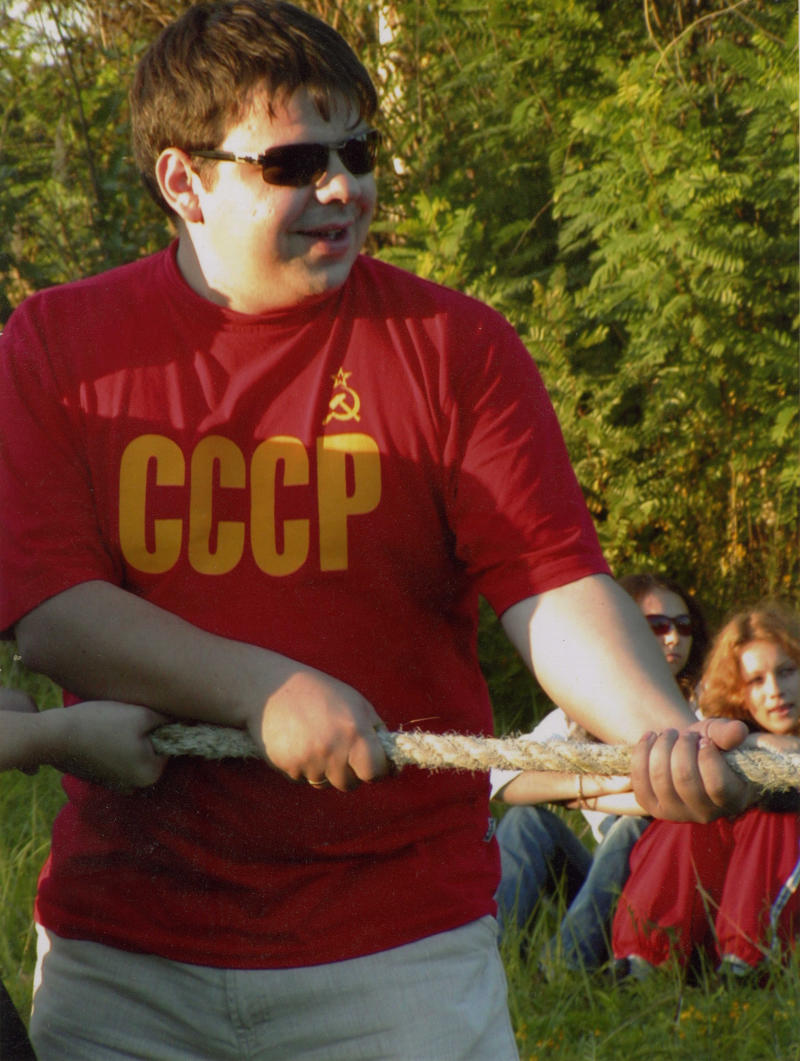In this 2004 family handout photo provided by Maksym Shynkarenko's sister Vladislava Silanteyva, shows Maksym Shynkarenko, wearing a T-shirt reading USSR,  photographed during a picnic with friends in Kiev, Ukarine. Shynkarenko, 33, from the eastern Ukrainian city of Kharkiv, has been charged in the United States with operating numerous Ukraine-based hardcore child porn sites and selling access to clients worldwide.  Shynkarenko has pleaded innocent to the charges in a Newark federal court.(AP Photo/A family handout photo provided by Vladislava Silanteyva)