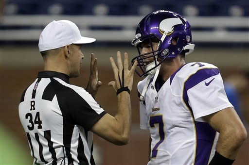 Referee Clete Blakeman (34) talks with Minnesota Vikings quarterback Christian Ponder during pregame warmups before an NFL football game against the Detroit Lions in Detroit Sunday, Sept. 30, 2012. (AP Photo/Paul Sancya)