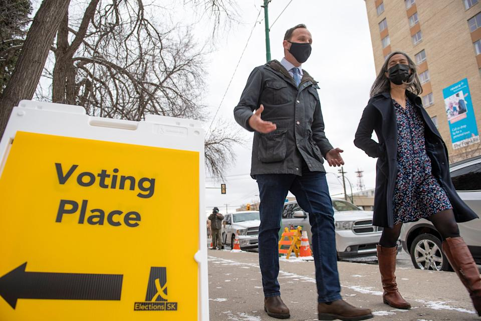 Saskatchewan New Democratic Party leader Ryan Meili, left, departing a polling station after voting in the advanced poll in Saskatoon, Tuesday, Oct. 20, 2020. (Photo: THE CANADIAN PRESS/Liam Richards)