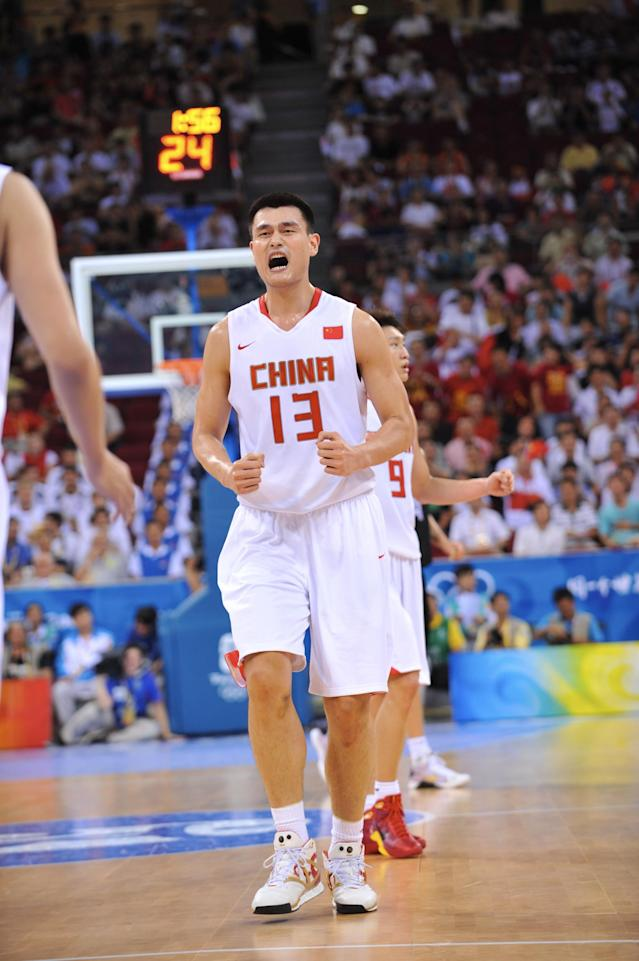 BEIJING - AUGUST 16: Yao Ming #13 of China celebrates against Germany during the group B preliminary basketball game at the Beijing Olympic Basketball Gymnasium on Day 8 of the Beijing 2008 Olympic Games on August 16, 2008 in Beijing, China. China won 59-55 NOTE TO USER: User expressly acknowledges and agrees that, by downloading and/or using this Photograph, user is consenting to the terms and conditions of the Getty Images License Agreement. Mandatory Copyright Notice: Copyright 2008 NBAE (Photo by Jesse D. Garrabrant/NBAE via Getty Images)