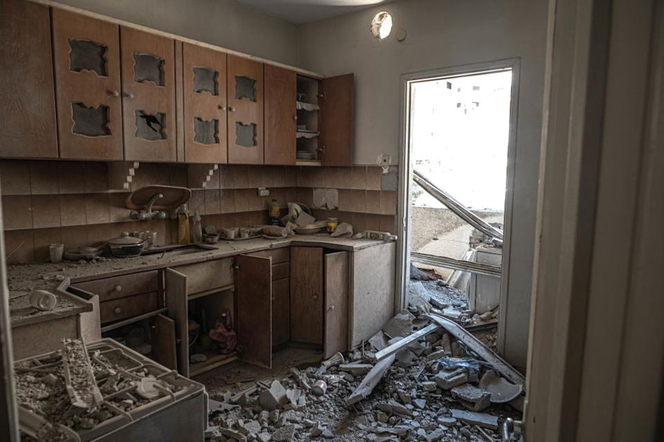 Damages inside the neighbouring houses of the bombing after heavy Israeli shelling on Al-Shati refugee camp, west of Gaza City.