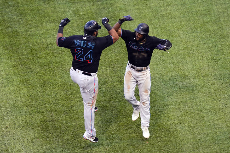 Jesus Aguilar celebrates with Starling Marte after hitting a home run in Game 1 of the wild-card series. The Marlins were victorious. (Photo by Nuccio DiNuzzo/MLB Photos via Getty Images)