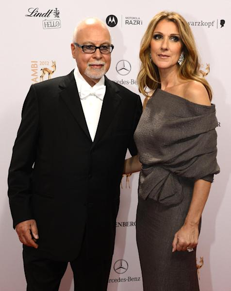 Canadian singer Celine Dion (R) and her husband Rene Angelil arrive for the Bambi Awards in Duesseldorf, western Germany on November 22, 2012 (AFP Photo/John MacDougall)