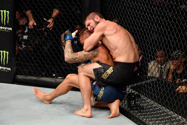 (R-L) Khabib Nurmagomedov submits Dustin Poirier in their lightweight championship bout during UFC 242 at The Arena on Sept. 7, 2019 in Yas Island, Abu Dhabi, United Arab Emirates. (Getty Images)