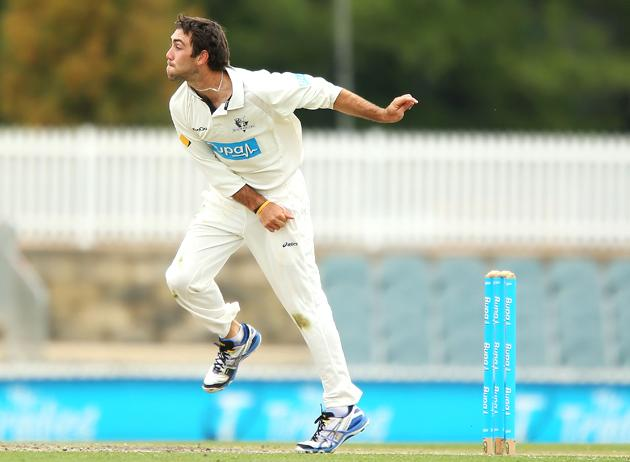 Glenn Maxwell of the Chairman's XI bowls during day two of the international tour match between the Chairman's XI and Sri Lanka at Manuka Oval on December 7, 2012 in Canberra, Australia.  (Photo by Brendon Thorne/Getty Images)