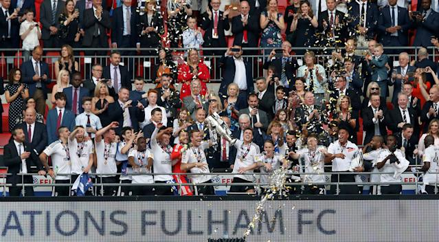 "Soccer Football - Championship Play-Off Final - Fulham vs Aston Villa - Wembley Stadium, London, Britain - May 26, 2018 Fulham's Tom Cairney celebrates promotion to the Premier League with the trophy and team mates Action Images via Reuters/Carl Recine EDITORIAL USE ONLY. No use with unauthorized audio, video, data, fixture lists, club/league logos or ""live"" services. Online in-match use limited to 75 images, no video emulation. No use in betting, games or single club/league/player publications. Please contact your account representative for further details."