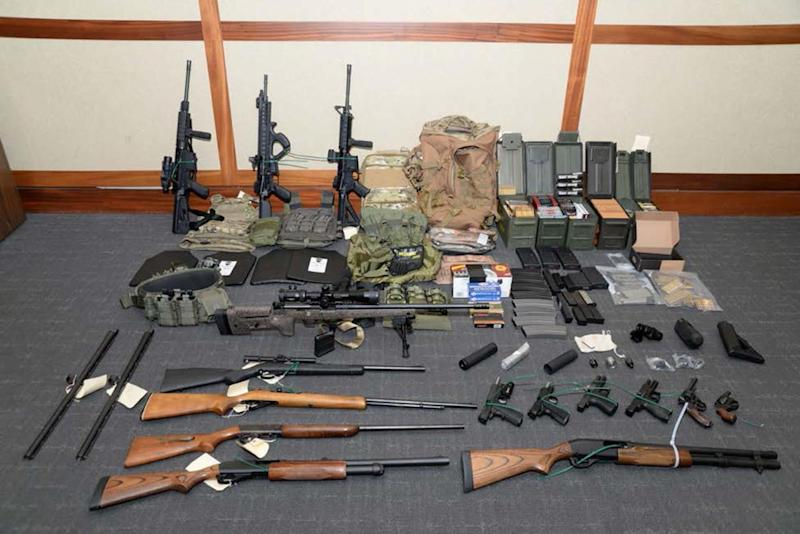 A cache of guns and ammunition uncovered by U.S. federal investigators in the home of U.S. Coast Guard lieutenant Christopher Paul Hasson in Silver Spring, Maryland, U.S., is shown in the photo provided February 20, 2019. U.S. Attorney's Office Maryland/H