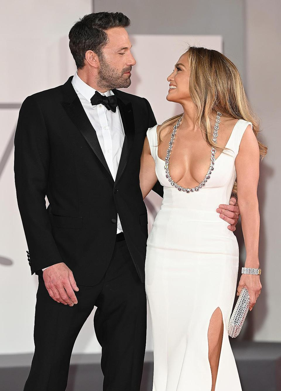 <p>The black tux. The white gown. The look of love. Is this photo setting off wedding bells in anyone else's head?! </p>