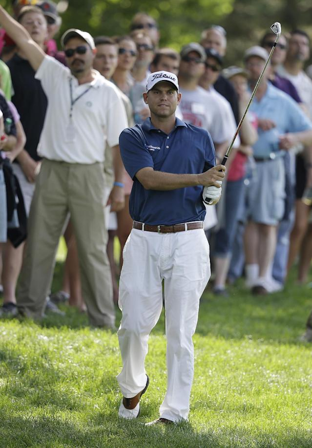 Bill Haas watches his second shot from the 13th fairway during the first round of the Memorial golf tournament Thursday, May 29, 2014, in Dublin, Ohio. (AP Photo/Darron Cummings)
