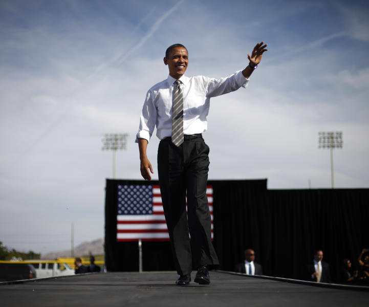 FILE - In this Nov. 1, 2012, file photo, President Barack Obama waves to supporters during a campaign event at Cheyenne Sports Complex in Las Vegas. A political generation ago, the West signaled the nation's rightward swing -- from the emergence of Ronald Reagan to the success of tax limitation ballot measures in California and Colorado. But now the fabled expanse of jagged peaks, arid deserts and emerald coastlines is trending in a different direction. From Washington state -- where voters in November legalized marijuana and upheld the legality of gay marriage -- to New Mexico, once a hotly-contested swing state that Republicans ceded to Democrats in the presidential campaign, the west has become solidly Democratic terrain. The coastal base states of Washington, Oregon and California continue to move further to left, while the hotly-contested swing states east of the Sierra Nevada are trending more and more toward the Democrats.(AP Photo/Pablo Martinez Monsivais, file)