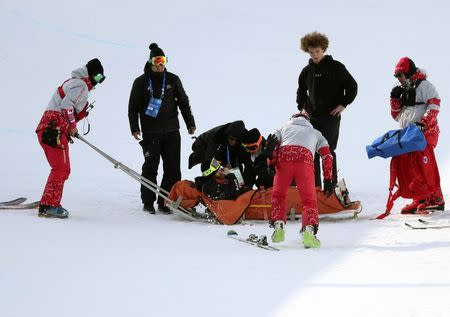 Freestyle Skiing - Pyeongchang 2018 Winter Olympics - Men's Ski Halfpipe Training - Phoenix Snow Park - Pyeongchang, South Korea - February 22, 2018 - Officials tend to Byron Wells of New Zealand after he crashed in training. REUTERS/Mike Blake