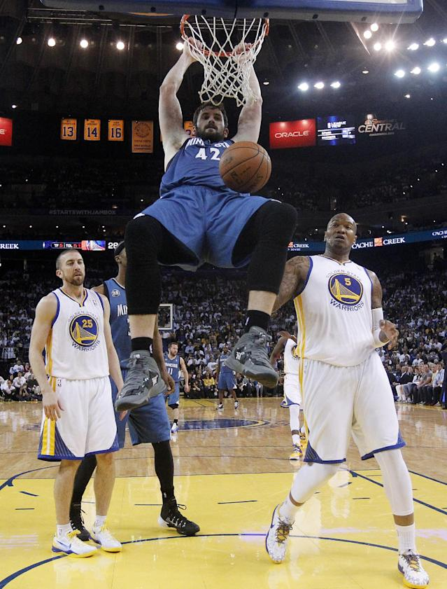 Minnesota Timberwolves' Kevin Love (42) dunks next to Golden State Warriors' Marreese Speights (5) and Steve Blake (25) during the first half of an NBA basketball game on Monday, April 14, 2014, in Oakland, Calif. (AP Photo/Marcio Jose Sanchez)