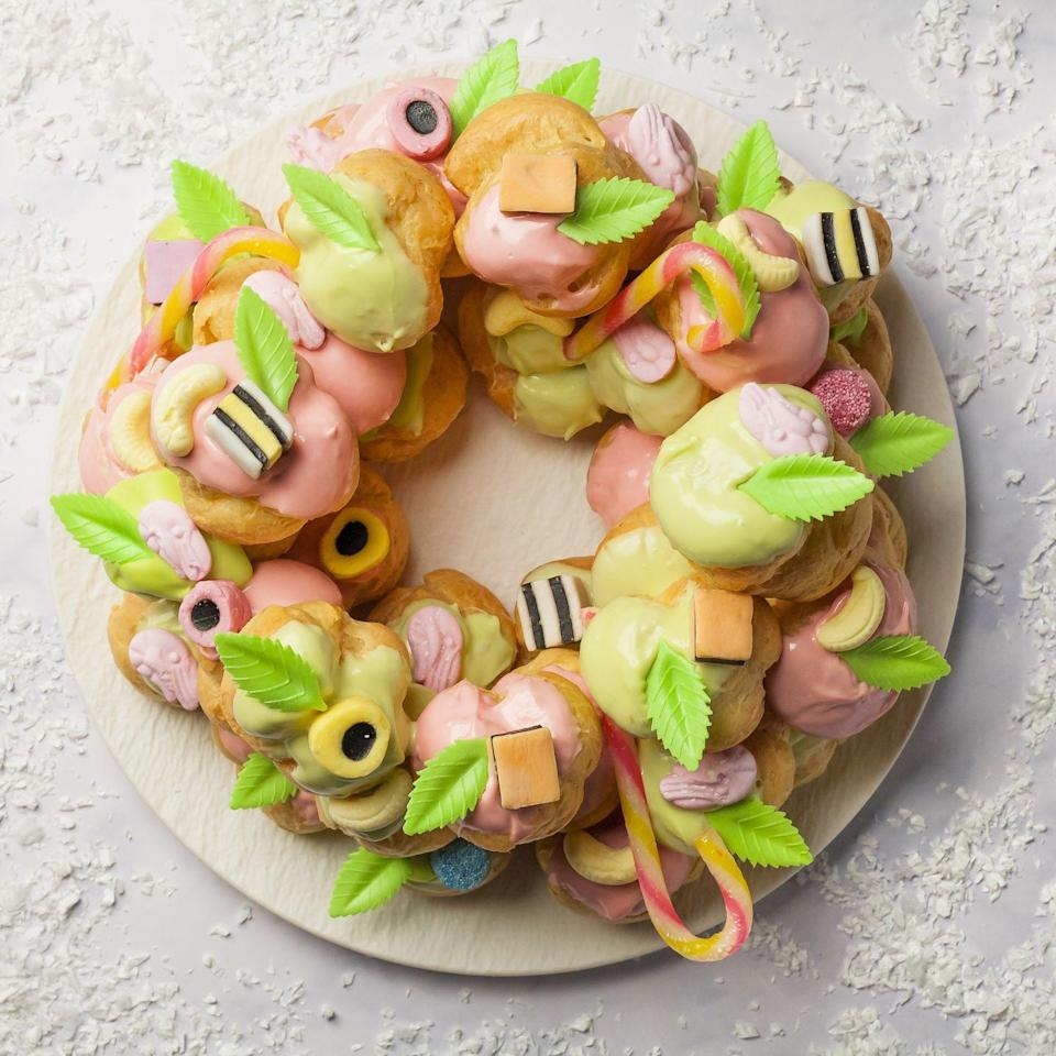 """<p>Adorn this profiterole wreath with any of your favourite Pick 'n' Mix sweets! This can be enjoyed all year round, using any colours you like to dye your chocolate.</p><p><strong>Recipes: <a href=""""https://www.goodhousekeeping.com/uk/christmas/christmas-recipes/a34699886/profiterole-pick-n-mix-wreath/"""" rel=""""nofollow noopener"""" target=""""_blank"""" data-ylk=""""slk:Profiterole Pick 'N' Mix Wreath"""" class=""""link rapid-noclick-resp"""">Profiterole Pick 'N' Mix Wreath </a></strong></p>"""