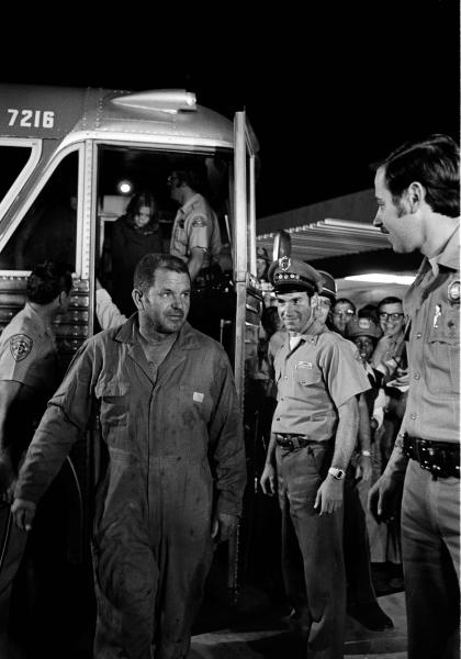 FILE - In this July 17, 1976 file photo, school bus driver Ed Ray Jr. steps from the bus that returned him and 26 school children home to Chowchilla, Calif., after the were kidnapped by three men. Ray, the school bus driver hailed as a hero for helping 26 students escape after three men kidnapped the group and buried the entire bus underground in 1976 died on Thursday, May 17, 2012. He was 91. (AP Photo)