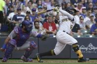 Milwaukee Brewers' Kolten Wong hits an RBI double during the fifth inning of a baseball game against the Chicago Cubs Sunday, Sept. 19, 2021, in Milwaukee. (AP Photo/Morry Gash)