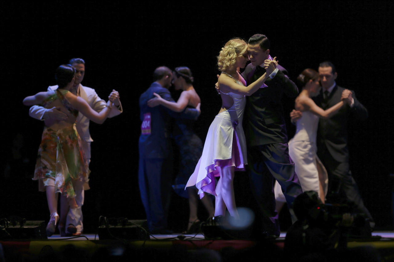 Russia's tango couple Dmitry Vasin, right, and Taya Finenkova compete during the 2012 Tango Dance World Cup salon finals in Buenos Aires, Argentina, Monday, Aug. 27, 2012. Couples from around the world competed in the finals Argentina's annual tango competition, the highlight of a two-week festival which this year honored Astor Piazzolla, the legendary composer and bandoneonista who revived the genre and infuriated purists by blending tango with rock music in the 1970s. Vasin and Finenkova finished fifth in the competition. (AP Photo/Natacha Pisarenko)