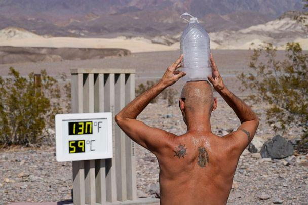 PHOTO: A man cools off with a bottle of ice water on his head in Death Valley National Park, Calif., Aug. 17, 2020. The temperature in the park reached 130 degrees on Aug. 16, hitting what may be the hottest temperature recorded on Earth since 1913. (John Locher/AP)
