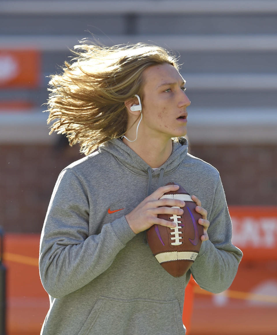 Clemson quarterback Trevor Lawrence passes the ball during drills before the start of an NCAA college football game against Louisville Saturday, Nov. 3, 2018, in Clemson, S.C. (AP Photo/Richard Shiro)