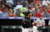 Colorado Rockies' Nolan Arenado watches his two-run home run off St. Louis Cardinals starting pitcher Michael Wacha during the first inning of a baseball game Tuesday, Sept. 10, 2019, in Denver. (AP Photo/David Zalubowski)