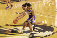 LSU's Cameron Thomas, right, and Missouri's Dru Smith, left, battle for a loose ball during the second half of an NCAA college basketball game Saturday, March 6, 2021, in Columbia, Mo. (AP Photo/L.G. Patterson)