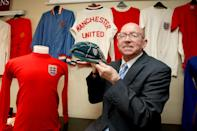 England World Cup winner Nobby Stiles holds his 1966 World Cup tournament cap, alongside the Alan Ball's 1966 England shirt, right, during a photocall at the Premier Inn Hotel in Old Trafford, Manchester. (Photo by Dave Thompson/PA Images via Getty Images)
