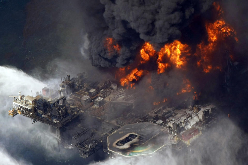 FILE - In an April 21, 2010, file photo taken in the Gulf of Mexico more than 50 miles southeast of Venice, La., the Deepwater Horizon oil rig burns. Jimmy Harrell, a supervisor on the Deepwater Horizon oil rig that exploded in the Gulf of Mexico in 2010, has died at age 65. Harrell, who worked for rig owner Transocean, died Monday, May 10, 2021, according to Wolf Funeral Home in Morton, Miss. He had battled cancer for a year. (AP Photo/Gerald Herbert, File)