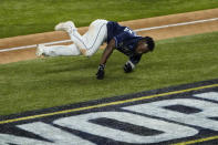 Tampa Bay Rays' Randy Arozarena fails on the way way to home plate during the ninth inning in Game 4 of the baseball World Series against the Los Angeles Dodgers Saturday, Oct. 24, 2020, in Arlington, Texas. Rays defeated the Dodgers 8-7 to tie the series 2-2 games. (AP Photo/Tony Gutierrez)