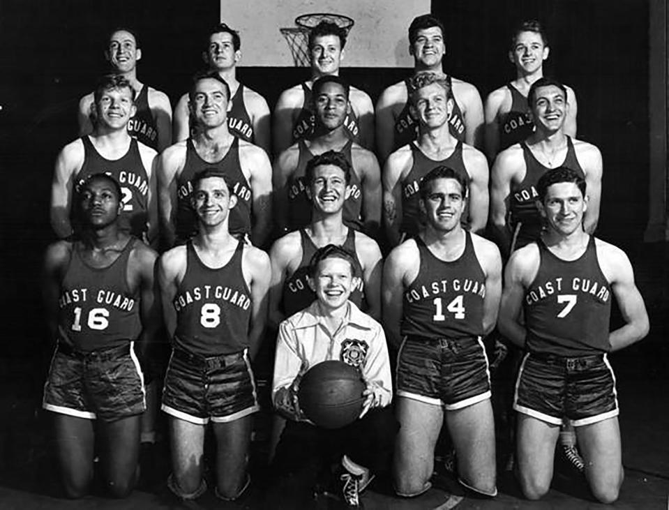 This undated photo provided by United States Coast Guard shows Emlen Tunnell, center, second from top, in a USCG basketball team photo, the first Black player inducted into the Pro Football Hall of Fame. Tunnell served in the Coast Guard during and after World War II, where he was credited with saving the lives of two shipmates in separate incidents. Now, a Coast Guard cutter and an athletic building on the Coast Guard Academy campus are being named in honor of the former New York Giants defensive back. (United States Coast Guard via AP)