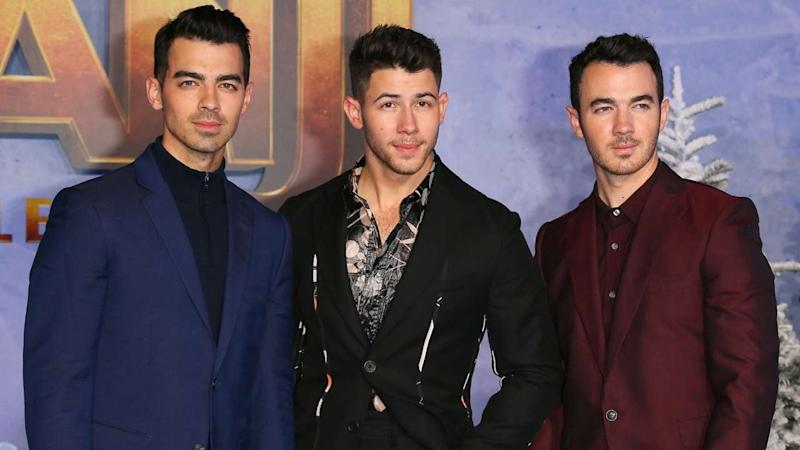 Nick Jonas Says Priyanka Chopra Is 'Jealous' His Brothers Got To Attend the 'Jumanji' Premiere (Exclusive)