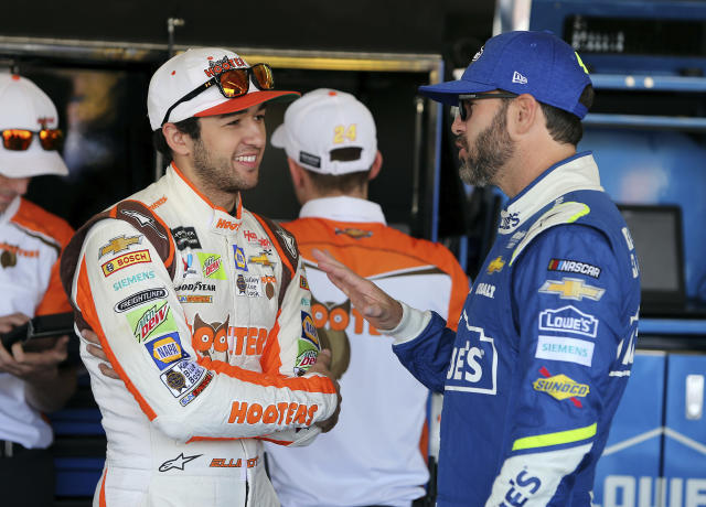 "<a class=""link rapid-noclick-resp"" href=""/nascar/sprint/drivers/3311/"" data-ylk=""slk:Chase Elliott"">Chase Elliott</a>, left, and <a class=""link rapid-noclick-resp"" href=""/nascar/sprint/drivers/213/"" data-ylk=""slk:Jimmie Johnson"">Jimmie Johnson</a> talk inside the garage area before practice for the NASCAR Cup Series auto race at Phoenix International Raceway, Friday, Nov. 10, 2017, in Avondale, Ariz. Both drivers are looking to fill the final spot for the Championship 4. (AP Photo/Ralph Freso)"