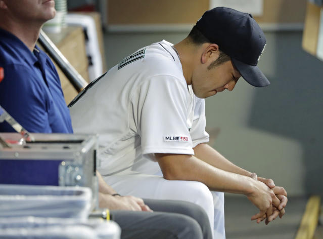 Seattle Mariners starting pitcher Yusei Kikuchi sits in the dugout after he was pulled in the fourth inning of the team's baseball game against the Los Angeles Angels, Thursday, May 30, 2019, in Seattle. (AP Photo/Ted S. Warren)