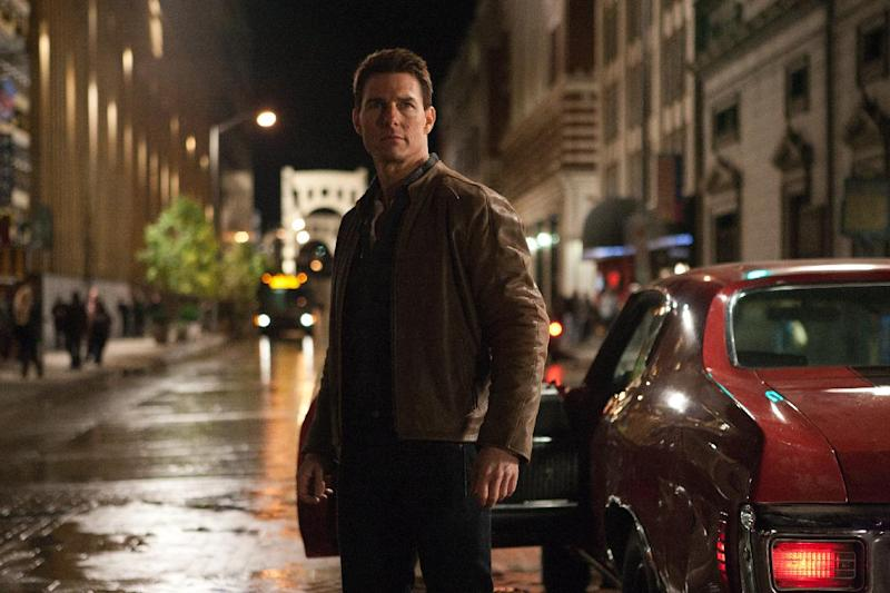 """FILE - This publicity film image released by Paramount Pictures shows Tom Cruise in a scene from """"Jack Reacher."""" Cruise plays a former military cop investigating a sniper case. The Film Society of Lincoln Center in New York canceled Monday's Dec. 17, 2012 screening of Tom Cruise's violent new movie, """"Jack Reacher,"""" that was to include a conversation with the actor. A scheduled premiere of the movie in Pittsburgh had also been postponed over the weekend. (AP Photo/Paramount Pictures, File)"""