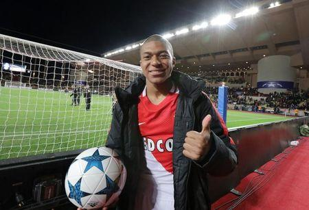 Monaco's Kylian Mbappe-Lottin celebrates after the match