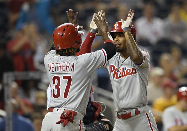 Philadelphia Phillies' Nick Williams, right, celebrates his two-run home run with Odubel Herrera (37) during the fifth inning of a baseball game against the Washington Nationals, Sunday, June 24, 2018, in Washington. (AP Photo/Nick Wass)