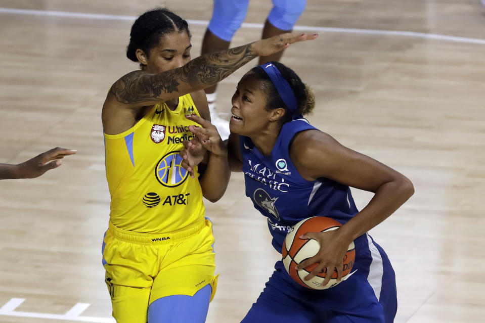Minnesota Lynx forward Napheesa Collier, right, (24) gets fouled by Chicago Sky forward Gabby Williams (15) during the first half of a WNBA basketball game Thursday, July 30, 2020, in Bradenton, Fla. (AP Photo/Chris O'Meara)
