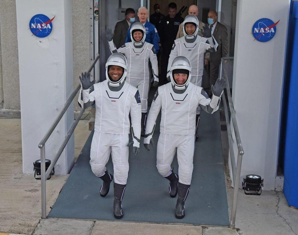 NASA astronauts, vehicle pilot Victor Glover (front L), commander Mike Hopkins (front R), mission specialist Shannon Walker (rear L) and mission specialist from the Japan Aerospace Exploration Agency (JAXA), astronaut Soichi Noguchi (rear R) walk out of the Operations and Checkout Building November 15, 2020 on their way to the SpaceX Falcon 9 rocket with the Crew Dragon spacecraft on launch pad 39A at the Kennedy Space Center on November 15, 2020 in Cape Canaveral, Florida. This will mark the second astronaut launch from U.S. soil by NASA and SpaceX and the first operational mission named Crew-1 to the International Space Station. (Photo by Red Huber/Getty Images)