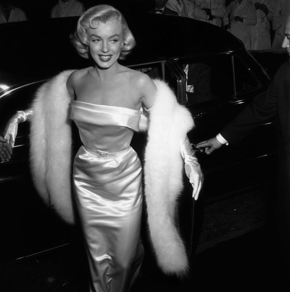 <p>Marilyn Monroe gets out of her car at the premiere of <em>There's No Business Like Show Business</em> in 1954.</p>