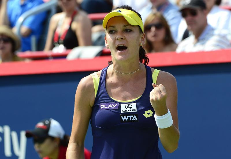 Agnieszka Radwanska, of Poland, reacts during her final match against Venus Williams, of the United States, during the Rogers Cup tennis tournament on Sunday, Aug. 10, 2014, in Montreal. (AP Photo/The Canadian Press, Paul Chiasson)