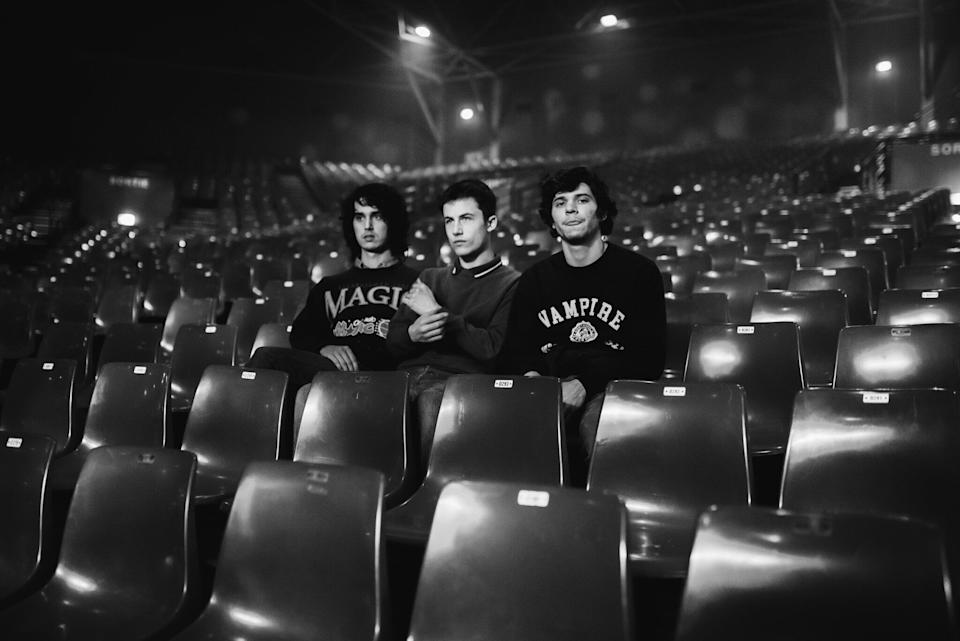 Wallows band members Cole Preston, Dylan Minnette and Braeden Lemasters in an empty theater.  (Photo: Joeseth Carter)