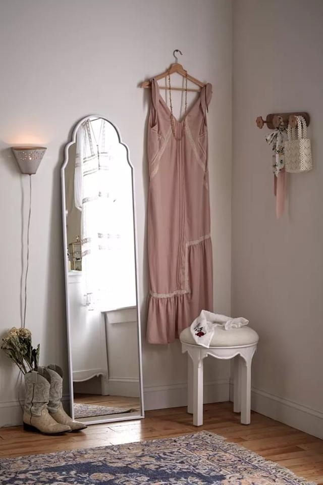 "<p>The charming aesthetic of this <a href=""https://www.popsugar.com/buy/Francine-Mirror-487948?p_name=Francine%20Mirror&retailer=urbanoutfitters.com&pid=487948&price=199&evar1=casa%3Aus&evar9=46580921&evar98=https%3A%2F%2Fwww.popsugar.com%2Fhome%2Fphoto-gallery%2F46580921%2Fimage%2F46581463%2FFrancine-Mirror&list1=shopping%2Curban%20outfitters%2Cfall%2Cfurniture%2Cfall%20decor%2Chome%20shopping&prop13=mobile&pdata=1"" rel=""nofollow"" data-shoppable-link=""1"" target=""_blank"" class=""ga-track"" data-ga-category=""Related"" data-ga-label=""https://www.urbanoutfitters.com/shop/francine-mirror?category=SEARCHRESULTS&amp;color=010&amp;type=REGULAR&amp;size=ONE%20SIZE&amp;quantity=1"" data-ga-action=""In-Line Links"">Francine Mirror</a> ($199) makes it a bedroom essential.</p>"
