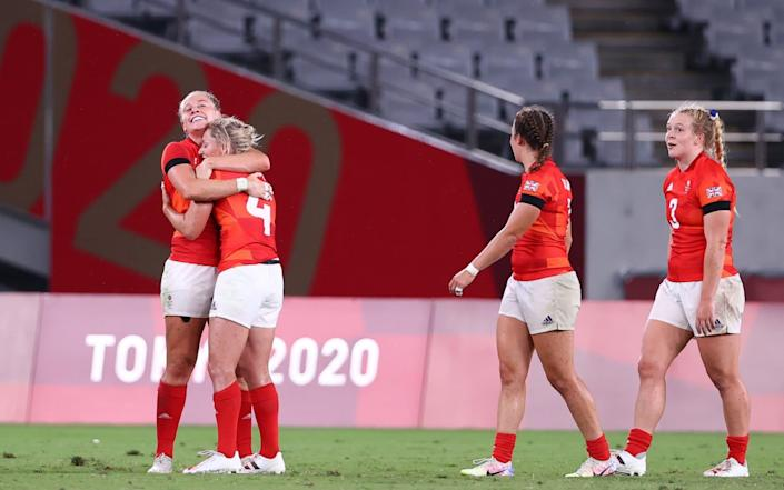 Great Britain celebrate at the final whistle - REUTERS