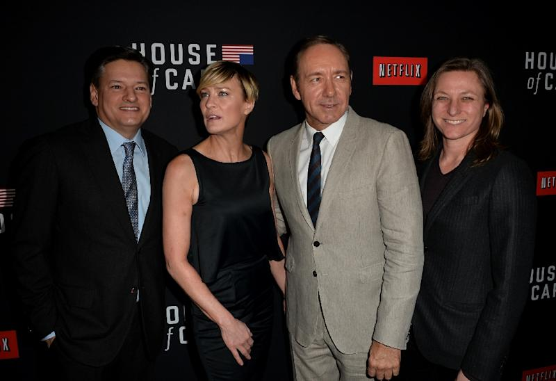 """Netflix chief content officer Ted Sarandos (L), actors Robin Wright and Kevin Spacey, and Netflix VP for original series Cindy Holland arrive at the special screening of Netflix's """"House of Cards"""" on February 13, 2014 in Los Angeles, California"""